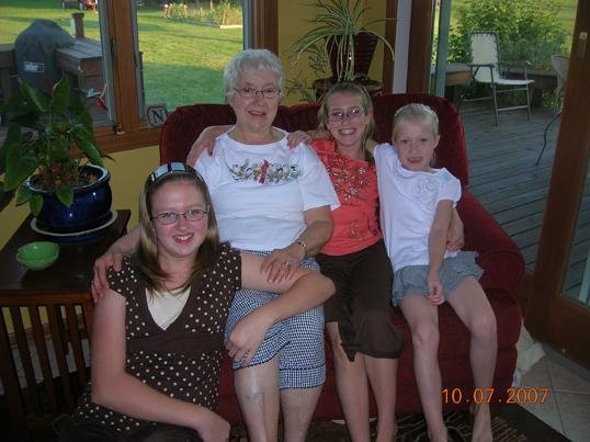 grma with girls on red chair